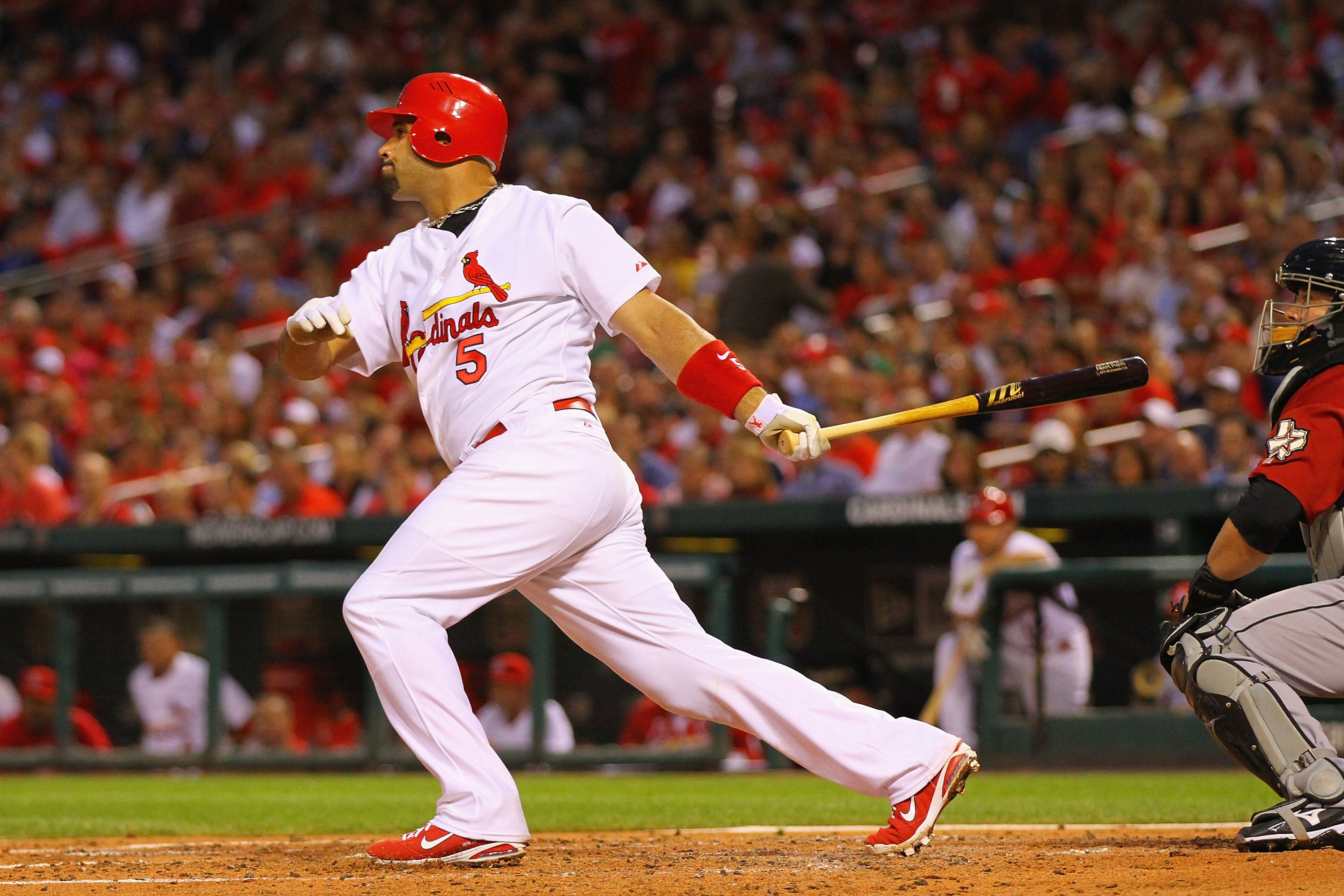 ST. LOUIS, MO - MAY 18: Albert Pujols #5 of the St.Louis Cardinals hits an RBI single against the Houston Astros at Busch Stadium on May 18, 2011 in St. Louis, Missouri.  (Photo by Dilip Vishwanat/Getty Images)