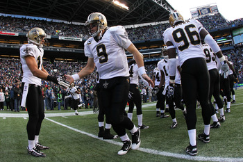 SEATTLE, WA - JANUARY 08:  Quarterback Drew Brees #9 of the New Orleans Saints is introduced before their game against the Seattle Seahawks during the 2011 NFC wild-card playoff game at Qwest Field on January 8, 2011 in Seattle, Washington.  (Photo by Ott