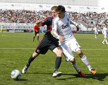 VANCOUVER, CANADA - MAY 28:  Omar Salgado #17 of the Vancouver Whitecaps FC and Tim Ream #5 of the New York Red Bulls battle for the ball during their MLS match  May 28, 2011 in Vancouver, British Columbia, Canada.  Vancouver and New York tied 1-1. (Photo