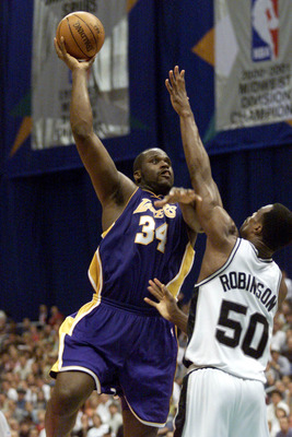 21 May 2001:  Shaquille O''Neal #34 of the Los Angeles Lakers puts a shot up against David Robinson #50 of the San Antonio Spurs in game two of the western conference finals at the Alamodome in San Antonio, Texas.  The Lakers won 88-81.  DIGITAL IMAGE. Ma