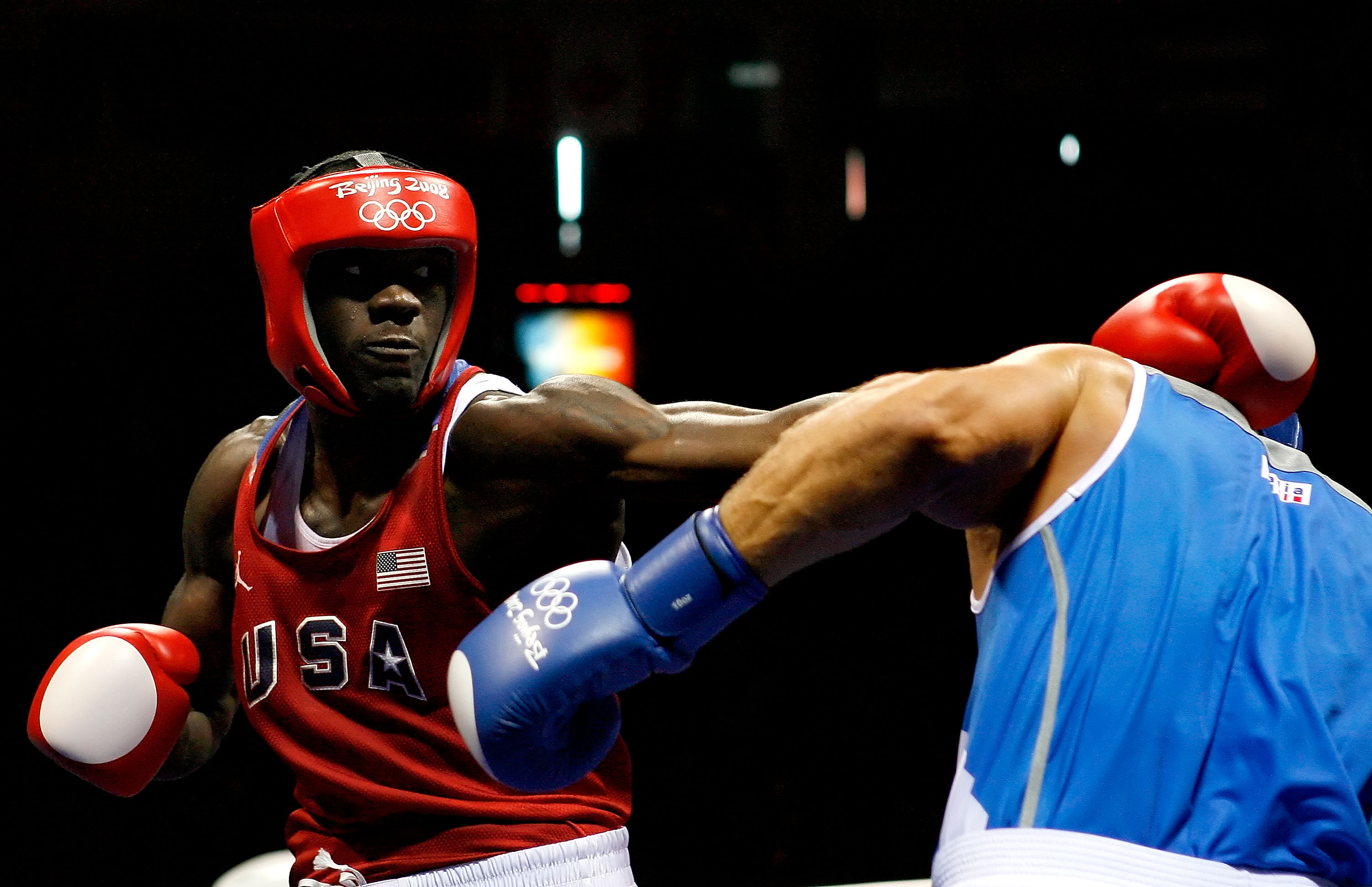 BEIJING - AUGUST 22:  Clemente Russo of Italy (blue) fights Deontay Wilder of the United States (red) in the Men's Heavy (91kg) Semifinal at the Workers' Indoor Arena on Day 14 of the Beijing 2008 Olympic Games on August 22, 2008 in Beijing, China. Russo