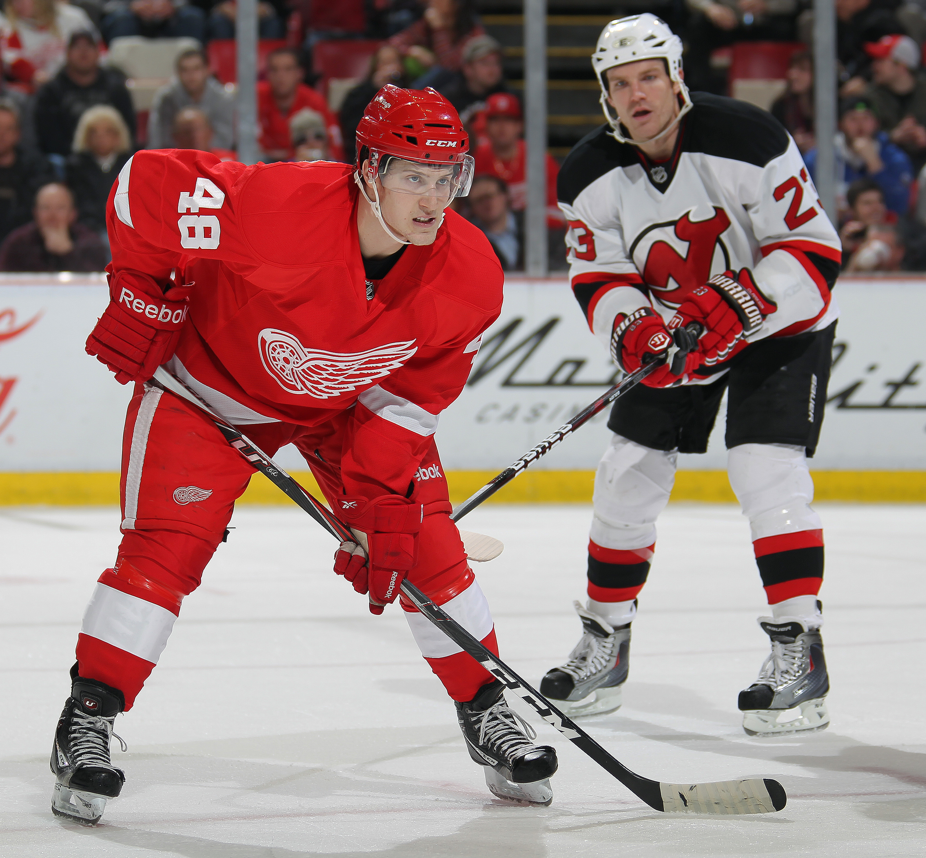 DETROIT, MI - JANUARY 26:  David Clarkson #23 of the New Jersey Devils reacts to the way rookie Cory Emmerton #48 of the Detroit Red Wings is lining up for a faceoff in a game on January 26, 2011 at the Joe Louis Arena in Detroit, Michigan. The Wings defe