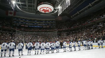 TORONTO - OCTOBER 4:  Too celebrate the achievements of three former Toronto Maple Leafs players, Leonard 'Red' Kelly, Clarence 'Hap' Day, and Borje Salming, members of  the Toronto Maple Leafs wear their numbers on their jerseys prior to the raising of t