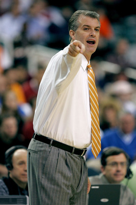 ATLANTA - MARCH 10:  Head coach Buzz Peterson of the Tennessee Volunteers points to the court during the first round of the SEC Men's Basketball Tournament against the Arkansas Razorbacks at the Georgia Dome on March 10, 2005 in Atlanta, Georgia. (Photo b