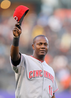 SAN FRANCISCO, CA - JUNE 09:  Edgar Renteria #16 of the Cincinnati Reds waves to the crowd after he received his World Series Championship ring that he won while playing for the San Francisco Giants last year before the Reds game against the Giants at AT&