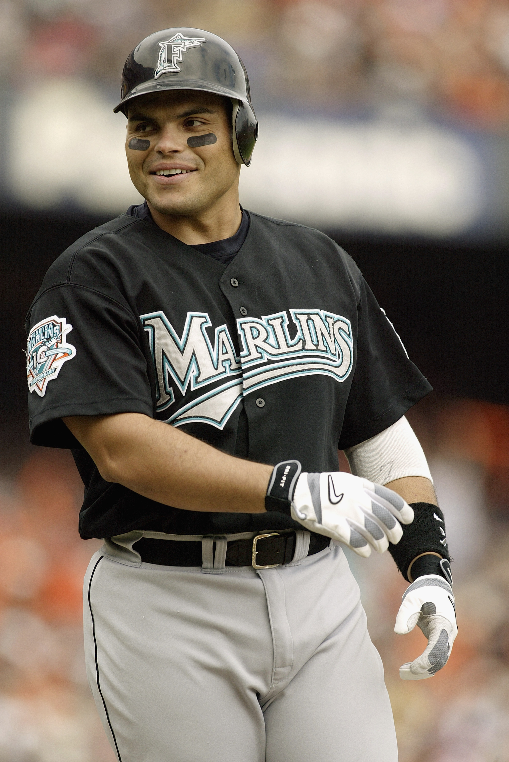 SAN FRANCISCO - OCTOBER 1:  Catcher Ivan Rodriguez #7 of the Florida Marlins smiles during Game 2 of the 2003 National League Division Series against the San Francisco Giants at Pacific Bell Park on October 1, 2003 in San Francisco, California.  The Marli