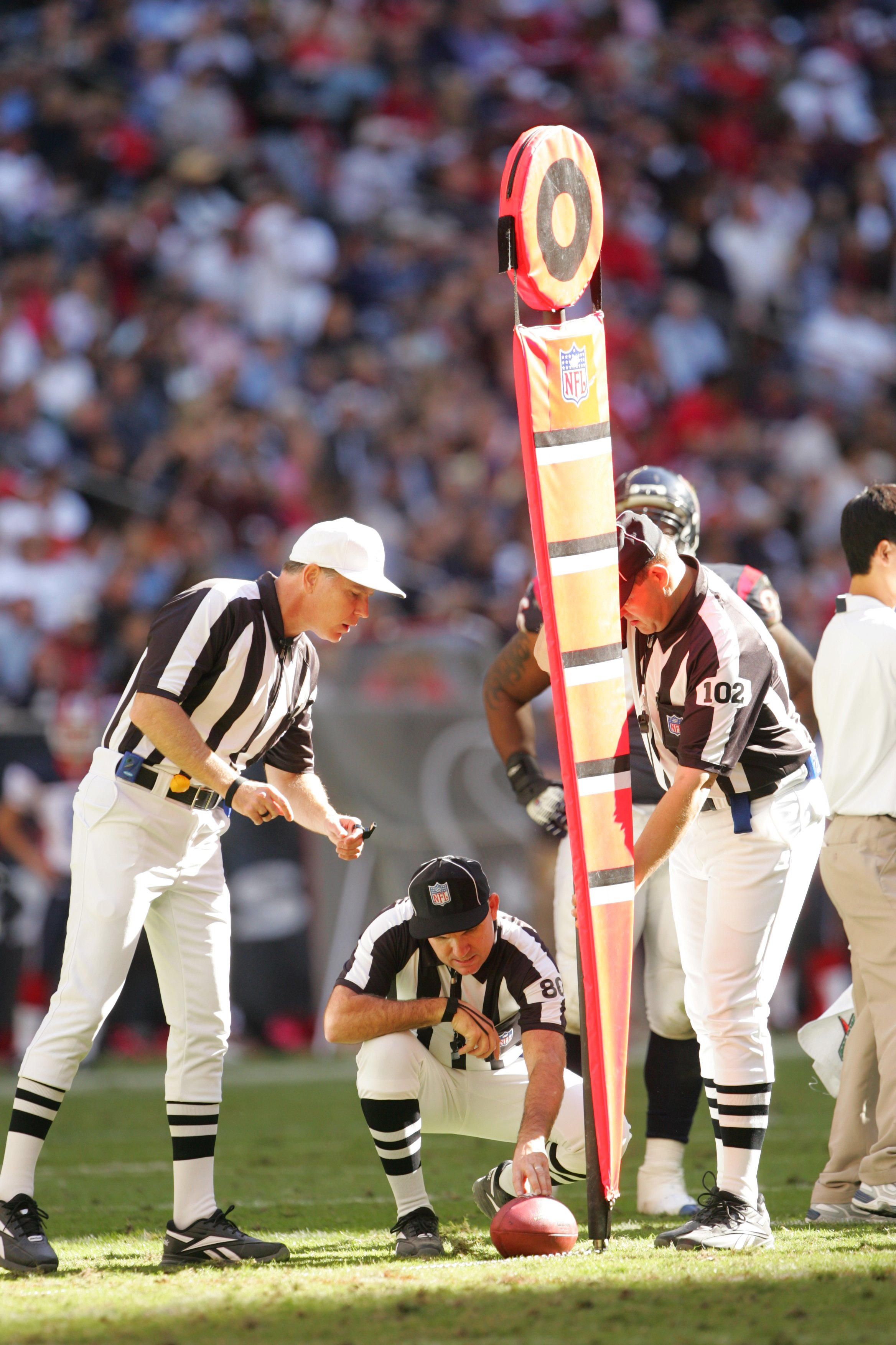 HOUSTON - NOVEMBER 19:  Referee Terry McAulay, field judge Greg Gautreaux and umpire Bruce Stritesky measure for a first down during the Buffalo Bills game against the Houston Texans on November 19, 2006 at Reliant Stadium in Houston, Texas. The Bills def