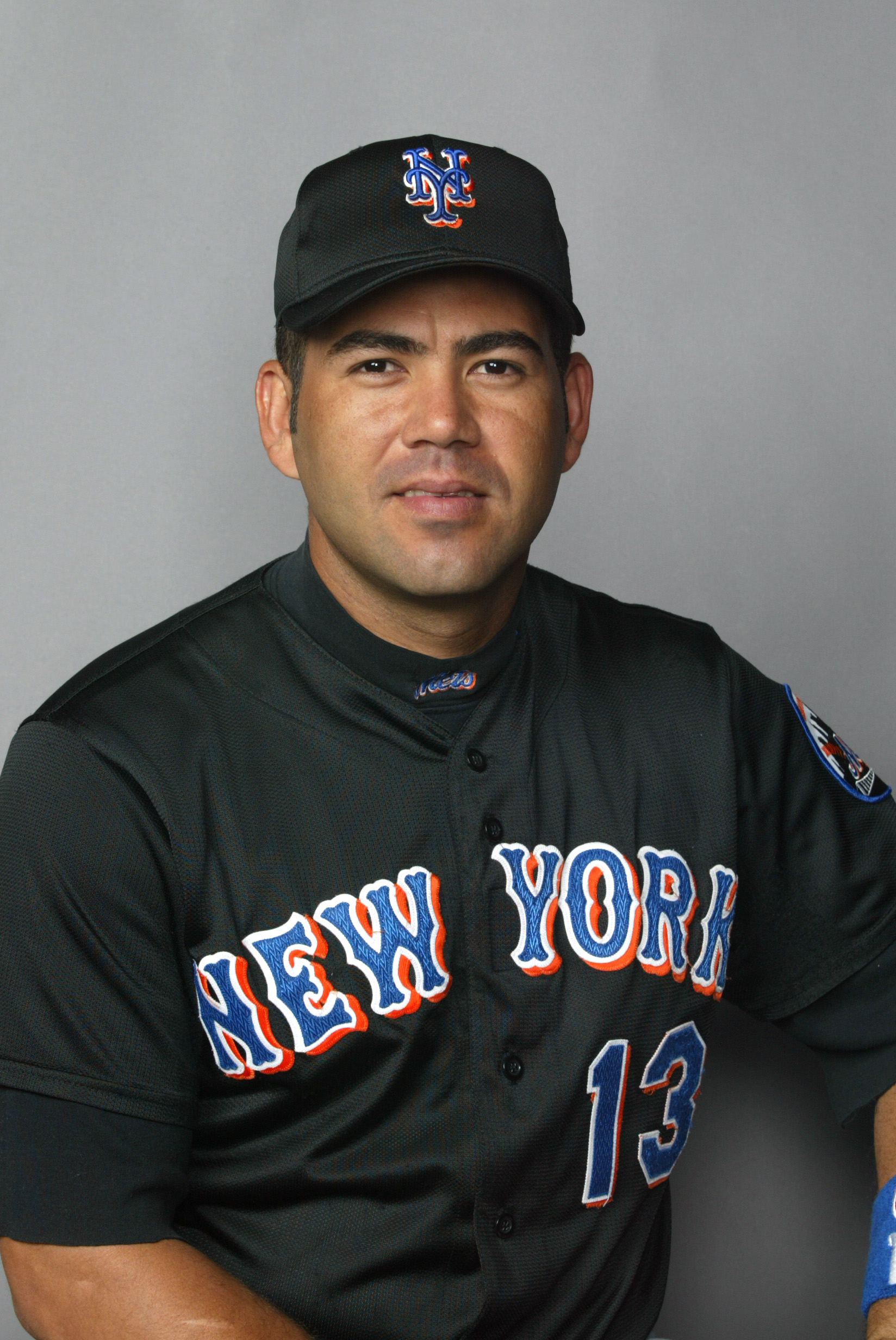 25 Feb 2002: Edgardo Alfonzo # 13 of the New York Mets posses for Spring Training Picture Day at Thomas J. White Stadium in Port St. Lucie Florida. DIGITAL IMAGE. Mandatory Credit: Eliot Schechter/Getty Images