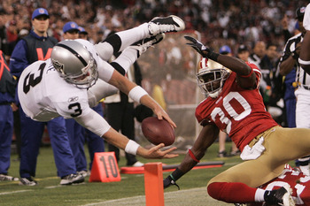 SAN FRANCISCO - AUGUST 22:  Oakland Raiders quarterback Charlie Frye #3 dives into the end zone for a touch down as San Francisco 49ers safety Reggie Smith tries to take him down as the San Francisco 49ers host the Oakland Raiders at Candlestick Park Augu