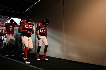 ATLANTA, GA - JANUARY 15:  (L-R) Quarterback Matt Ryan #2, John Abraham #55 and Roddy White #84 of the Atlanta Falcons walk to the locker room from the field following warm ups against the Green Bay Packers during their 2011 NFC divisional playoff game at