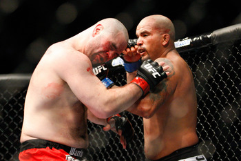MONTREAL- MAY 8: Joey Beltran (R) punches Tim Hague in their heavyweight bout at UFC 113 at Bell Centre on May 8, 2010 in Montreal, Quebec, Canada.  (Photo by Richard Wolowicz/Getty Images)