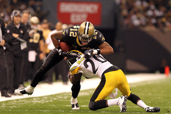 NEW ORLEANS, LA - OCTOBER 31: Marques Colston #12 of the New Orleans Saints is tackled by Bryant McFadden #20 of the Pittsburgh Steelers at the Louisiana Superdome on October 31, 2010 in New Orleans, Louisiana. (Photo by Matthew Sharpe/Getty Images)