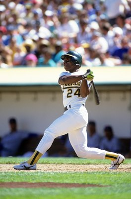 OAKLAND, CA - CIRCA 1990:  Rickey Henderson #24 of the Oakland Athletics bats during an MLB game at Oakland-Alameda Coliseum circa 1990 in Oakland, California. (Photo by Otto Greule Jr./Getty Images)