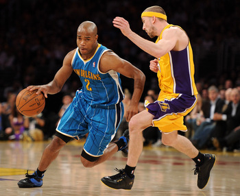 LOS ANGELES, CA - APRIL 26:  Jarrett Jack #2 of the New Orleans Hornets drives on Steve Blake #5 of the Los Angeles Lakers in Game Five of the Western Conference Quarterfinals in the 2011 NBA Playoffs on April 26, 2011 at Staples Center in Los Angeles, Ca
