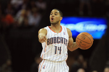 CHARLOTTE, NC - FEBRUARY 14:  D.J. Augustin #14 of the Charlotte Bobcats during their game at Time Warner Cable Arena on February 14, 2011 in Charlotte, North Carolina. NOTE TO USER: User expressly acknowledges and agrees that, by downloading and/or using