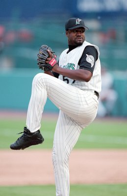 30 Jul 2000: Antonio Alfonseca #57 of the Florida Marlins winds back to pitch the ball during the game against the Arizona Diamondbacks at the Pro Player Stadium in Miami, Florida. The Marlins defeated the Diamondbacks 4-3.Mandatory Credit: Eliot J. Schec