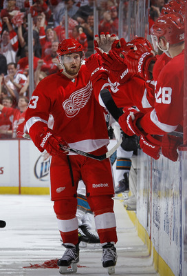 DETROIT - MAY 10: Darren Helm #43 of the Detroit Red Wings celebrates his third period empty net goal with the bench while playing the San Jose Sharks in Game Six of the Western Conference Semifinals during the 2011 NHL Stanley Cup Playoffs on May 10, 201