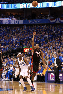 DALLAS, TX - JUNE 09:  Mario Chalmers #15 of the Miami Heat makes a 3-point basket at the buzzer of the end of the first quarter against the Jason Terry #31 of the Dallas Mavericks in Game Five of the 2011 NBA Finals at American Airlines Center on June 9,
