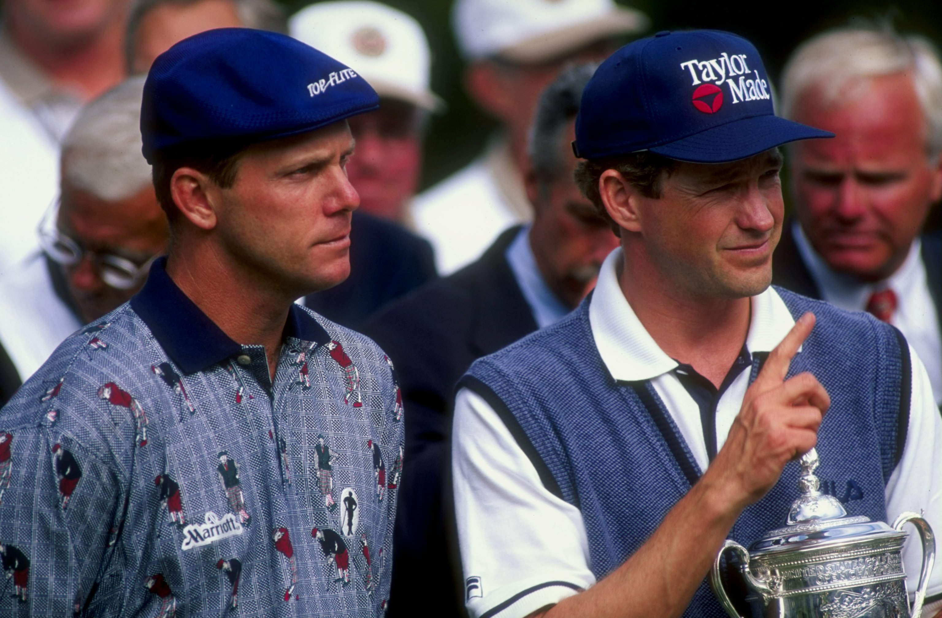 21 Jun 1998:  Lee Janzen of the USA poses with the trophy as Payne Stewart of the USA looks on.  Janzen won the 1998 U.S. Open Championships on the 6,797-yard, par-70 Lake Course at The Olympic Club in San Francisco, California. Mandatory Credit: Craig Jo