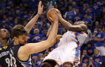 OKLAHOMA CITY, OK - MAY 15:  Forward Kevin Durant #35 of the Oklahoma City Thunder is fouled by Marc Gasol #33 of the Memphis Grizzlies in Game Seven of the Western Conference Semifinals in the 2011 NBA Playoffs on May 15, 2011 at Oklahoma City Arena in O