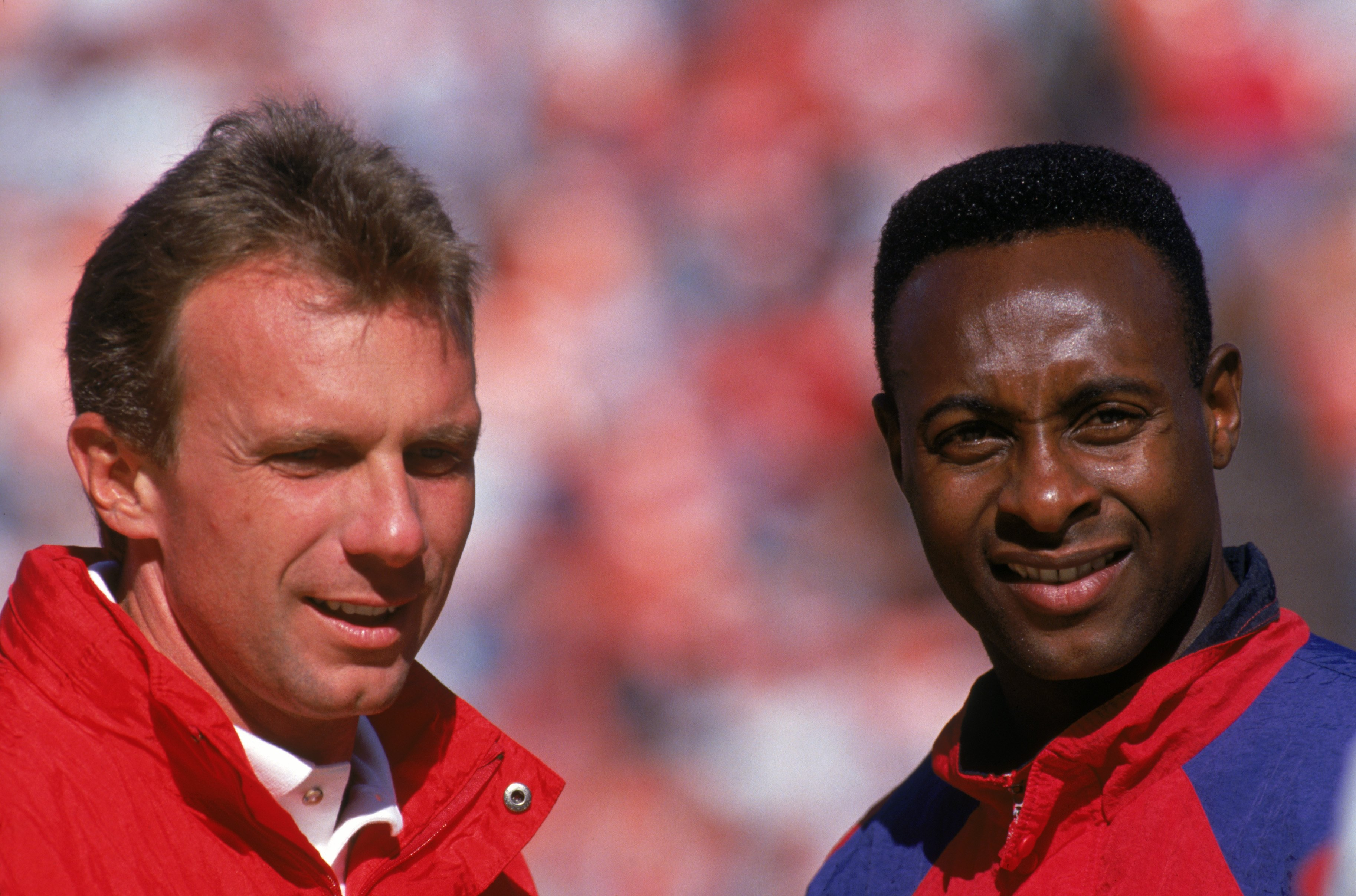 AUGUST 3:  Quarterback Joe Montana #16 and wide receiver Jerry Rice #80 of the San Francisco 49ers look on during a preseason game against the Denver Broncos on August 3, 1992.  The 49ers won 13-7.  (Photo by George Rose/Getty Images)
