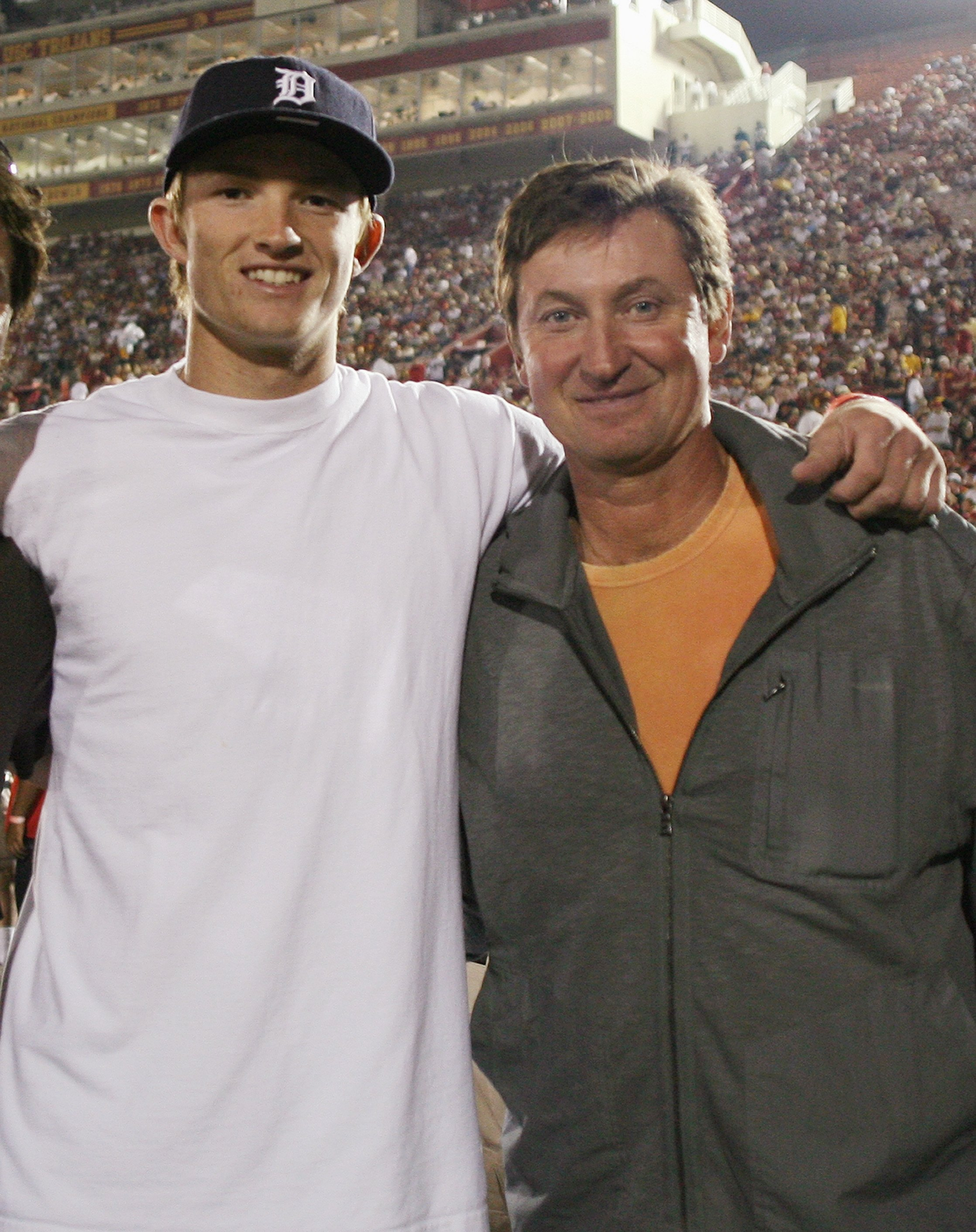 LOS ANGELES - SEPTEMBER 26:  Trevor Gretzky and Wayne Gretzky smile for a photo in the endzone before the game between the Washington State Cougars and the USC Trojans on September 26, 2009 at the Los Angeles Coliseum in Los Angeles, California.  (Photo b