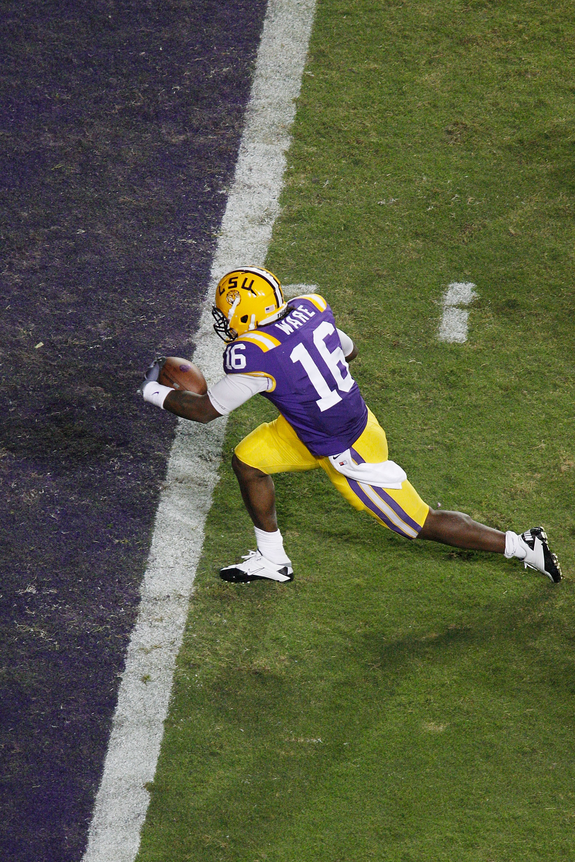 BATON ROUGE, LA - NOVEMBER 13:  Spencer Ware #16 of the Louisiana State University Tigers scores a touchdown during the game against the University of Louisiana-Monroe Warhawks at Tiger Stadium on November 13, 2010 in Baton Rouge, Louisiana. The Tigers de