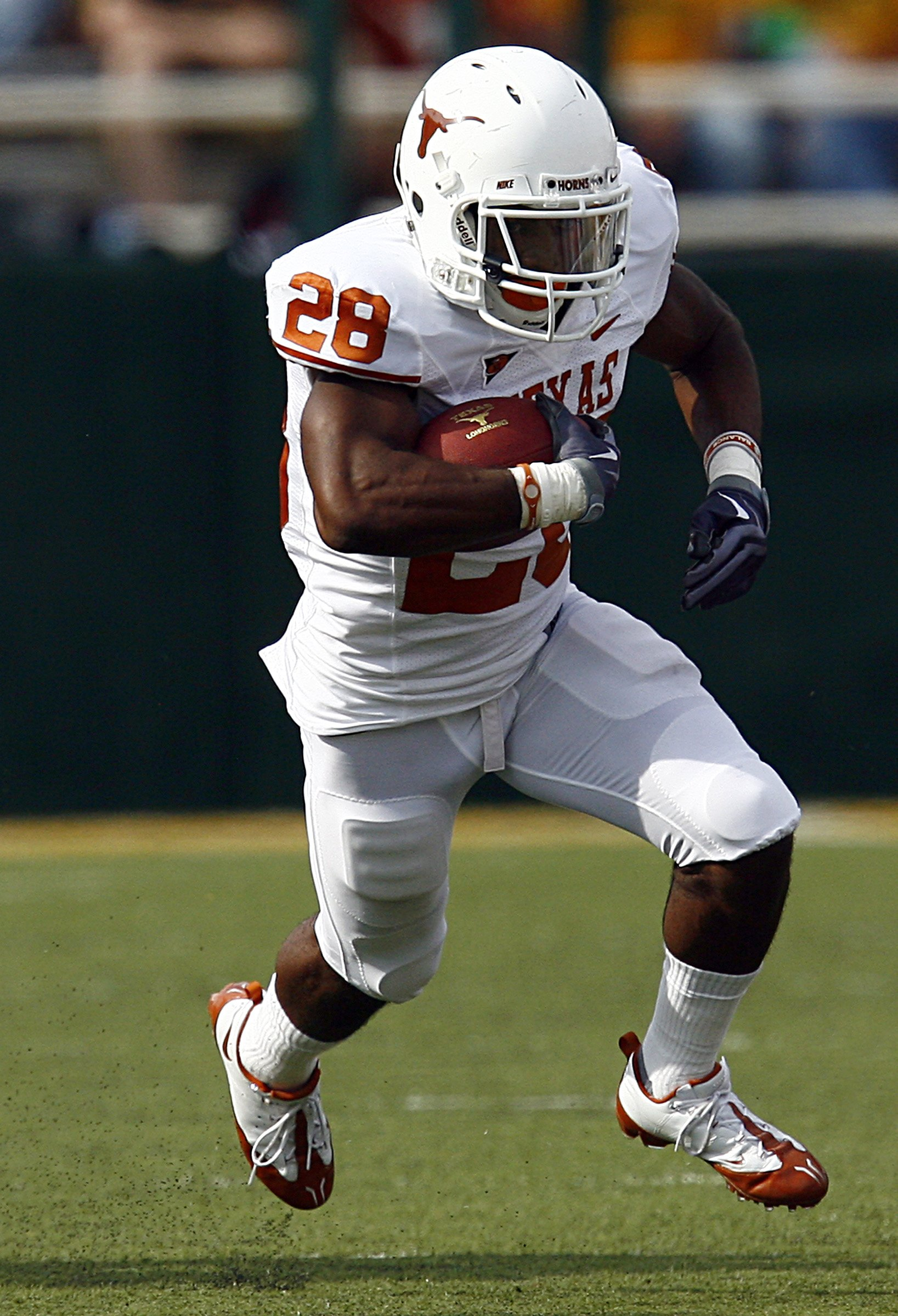 WACO, TX - NOVEMBER 14:  Running back Fozzy Whittaker #28 of the Texas Longhorns carries the ball in the first half against the Baylor Bears on November 14, 2009 at Floyd Casey Stadium in Waco, Texas.   The Longhorns beat the Bears 47-14.  (Photo by Tom P