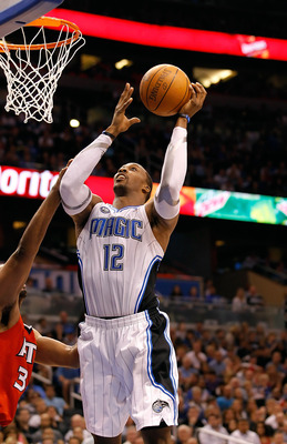 ORLANDO, FL - APRIL 16:  Dwight Howard #12 of the Orlando Magic lays the ball up against the Atlanta Hawks during Game One of the Eastern Conference Quarterfinals of the 2011 NBA Playoffs on April 16, 2011 at the Amway Arena in Orlando, Florida.  NOTE TO