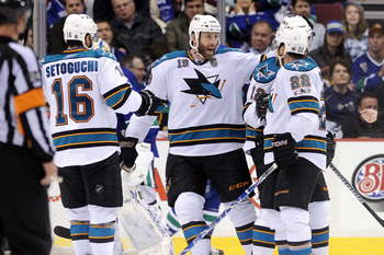 VANCOUVER, CANADA - MAY 15:  Devin Setoguchi #16, Joe Thornton #19 and Dan Boyle #22 of the San Jose Sharks celebrate with teammate Patrick Marleau #12 after Marleau's goal in Game One of the Western Conference Finals against the Vancouver Canucks during