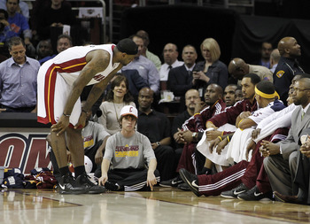 CLEVELAND, OH - DECEMBER 02:  LeBron James #6 of the Miami Heat talks to the Cleveland Cavaliers bench during a game at Quicken Loans Arena on December 2, 2010 in Cleveland, Ohio. NOTE TO USER: User expressly acknowledges and agrees that, by downloading a