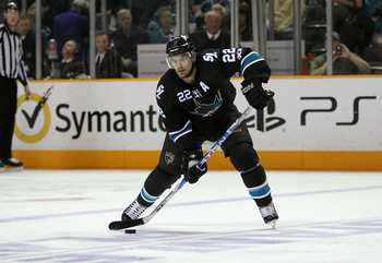 SAN JOSE, CA - MAY 22:   Dan Boyle #22 of the San Jose Sharks passes the puck from the point in Game Four of the Western Conference Finals against the Vancouver Canucks during the 2011 Stanley Cup Playoffs at HP Pavilion on May 22, 2011 in San Jose, Calif