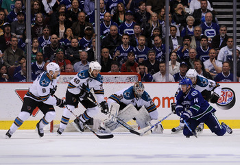 VANCOUVER, CANADA - MAY 24:  Joe Pavelski #8, Kent Huskins #40, goaltender Antti Niemi #31, and Marc-Edouard Vlasic #44 of the San Jose Sharks defend the play of Alex Burrows #14 of the Vancouver Canucks in Game Five of the Western Conference Finals durin