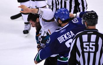 Patrick Marleau fights Vancouver defenseman Kevin Bieksa in the Western Conference Finals.