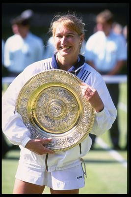 6 Jul 1996:  Steffi Graf of Germany once again holds the womens singles trophy after her straight sets victory over Arantxa Sanchez Vicario of Spain during the Wimbledon tennis championships at the all England Club in London, England.Mandatory Credit: Cli