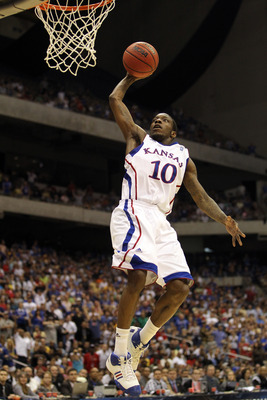SAN ANTONIO, TX - MARCH 27:  Tyshawn Taylor #10 of the Kansas Jayhawks dunks against the Virginia Commonwealth Rams during the southwest regional final of the 2011 NCAA men's basketball tournament at the Alamodome on March 27, 2011 in San Antonio, Texas.