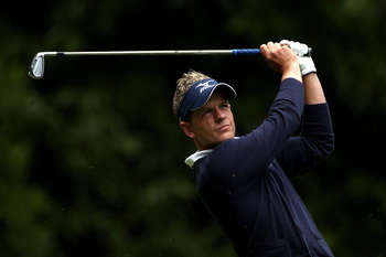 VIRGINIA WATER, ENGLAND - MAY 29:  Luke Donald of England tees off on the 2nd hole during the final round of the BMW PGA Championship  at the Wentworth Club on May 29, 2011 in Virginia Water, England.  (Photo by Warren Little/Getty Images)