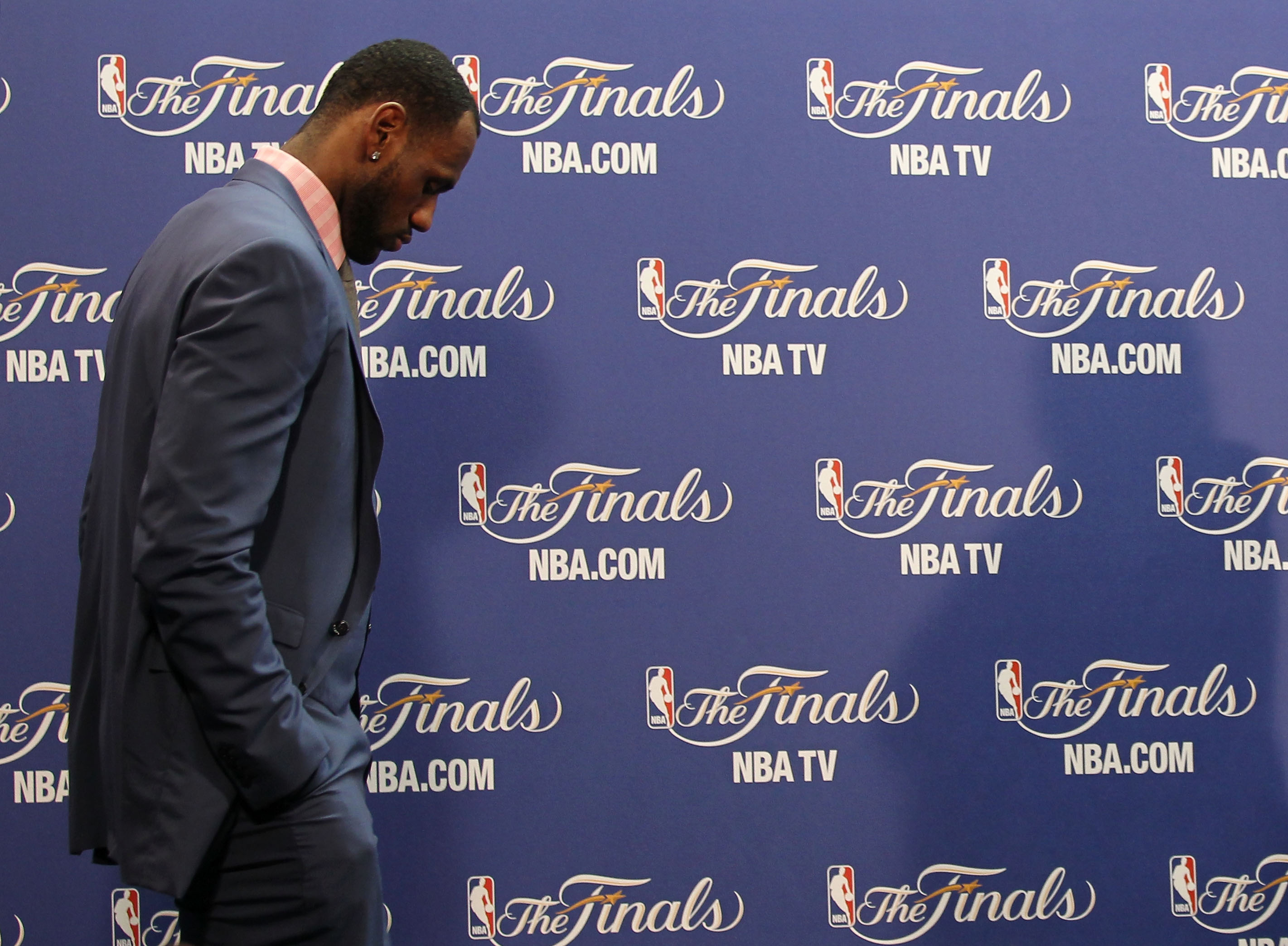 MIAMI, FL - JUNE 12:  LeBron James #6 of the Miami Heat walks into the interview room to answer questions after the Heat were defeated 105-95 by the Dallas Mavericks in Game Six of the 2011 NBA Finals at American Airlines Arena on June 12, 2011 in Miami,