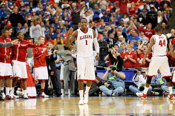 ATLANTA, GA - MARCH 11:  JaMychal Green #1 of the Alabama Crimson Tide celebrates after defeating the Georgia Bulldogs 65 to 59 in the quarterfinals of the SEC Men's Basketball Tournament at Georgia Dome on March 11, 2011 in Atlanta, Georgia.  (Photo by K