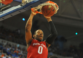 GAINESVILLE, FL - NOVEMBER 16: Forward Jared Sullinger #0 of the Ohio State Buckeyes scores against the Florida Gators November 16, 2010 at the Stephen C. O'Connell Center in Gainesville, Florida.  (Photo by Al Messerschmidt/Getty Images)