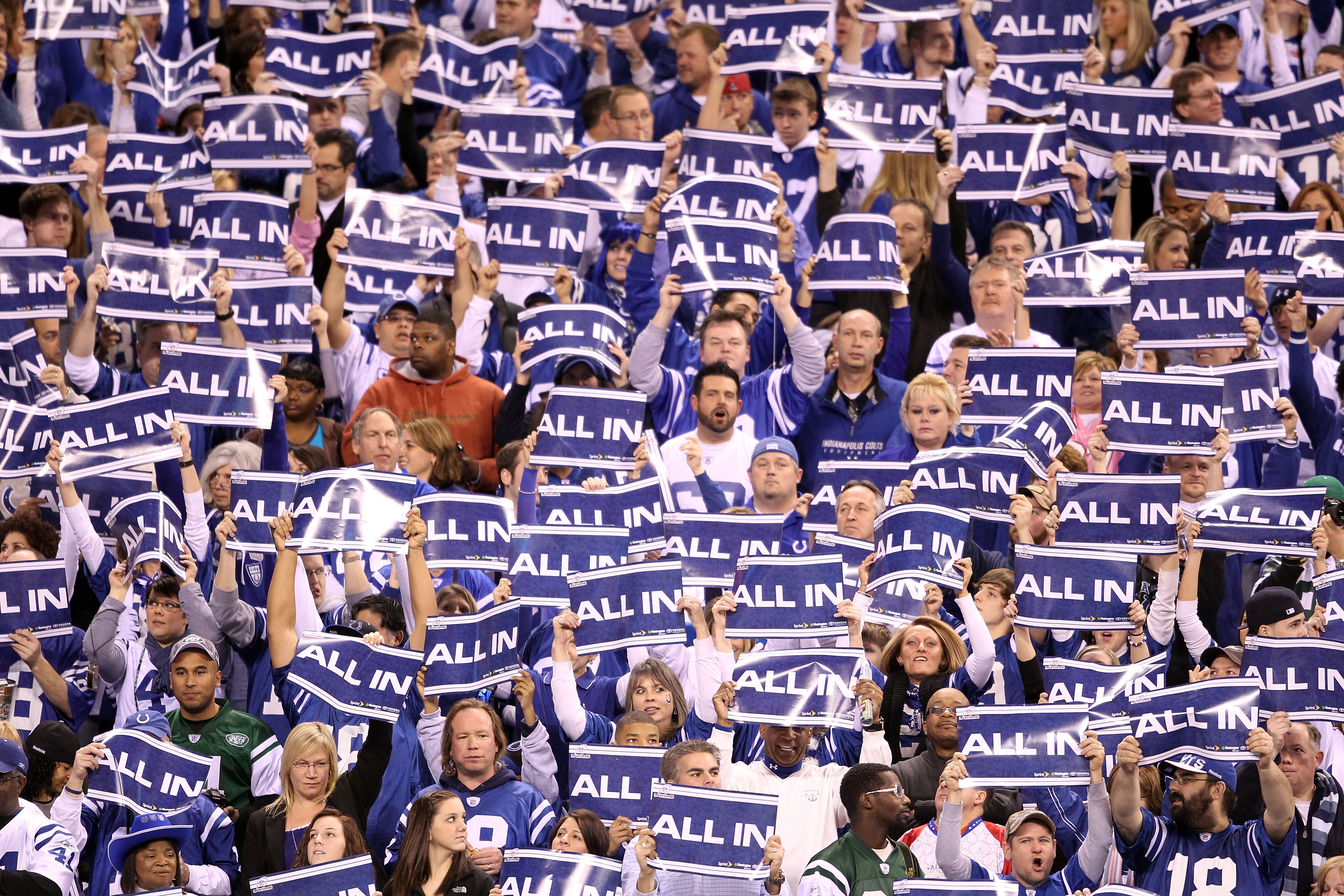 INDIANAPOLIS, IN - JANUARY 08:  Fans of the Indianapolis Colts hold up signs which read 'All In' in support of their team against the New York Jets during their 2011 AFC wild card playoff game at Lucas Oil Stadium on January 8, 2011 in Indianapolis, India