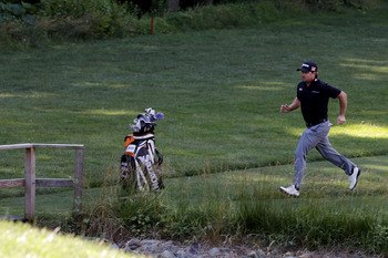 BETHESDA, MD - JUNE 13:  Graeme McDowell of Northern Ireland runs to a tee box during a practice round prior to the start of the 111th U.S. Open at Congressional Country Club on June 13, 2011 in Bethesda, Maryland.  (Photo by Ross Kinnaird/Getty Images)