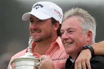 PEBBLE BEACH, CA - JUNE 20:  Graeme McDowell (L) of Northern Ireland celebrates with the trophy alongside his father Ken on the 18th green after winning the 110th U.S. Open at Pebble Beach Golf Links on June 20, 2010 in Pebble Beach, California.  (Photo b