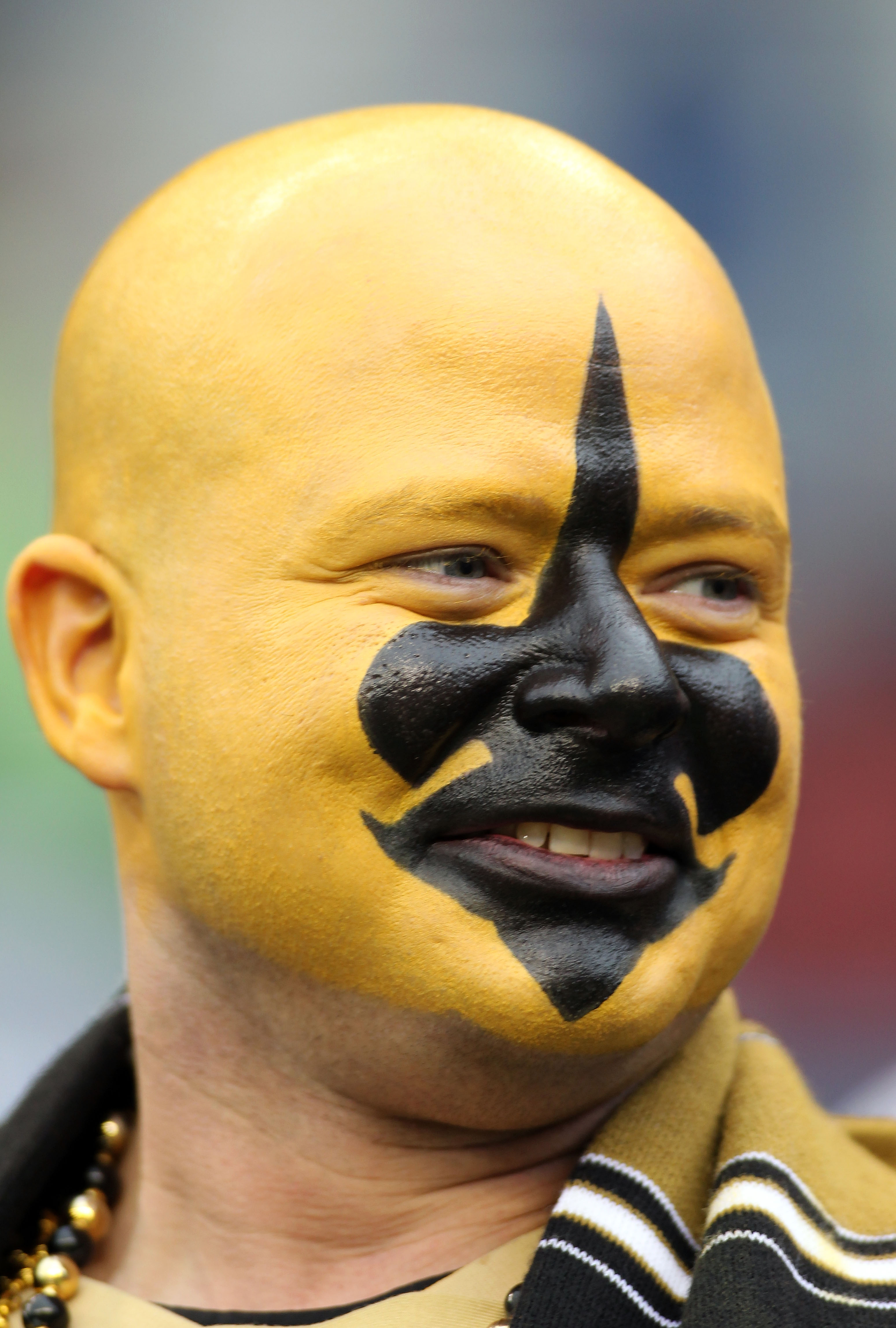 SEATTLE, WA - JANUARY 08:  A New Orleans Saints fan smiles before the Saints take on the Seattle Seahawks during the 2011 NFC wild-card playoff game at Qwest Field on January 8, 2011 in Seattle, Washington.  (Photo by Jonathan Ferrey/Getty Images)