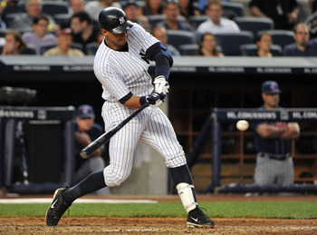 NEW YORK, NY - JUNE 10: Alex Rodriguez #13 of the New York Yankees  connects for a solo home run in the bottom of the fourth inning against the Cleveland Indians on June 10, 2011 at Yankee Stadium in the Bronx borough of New York City. (Photo by Christoph