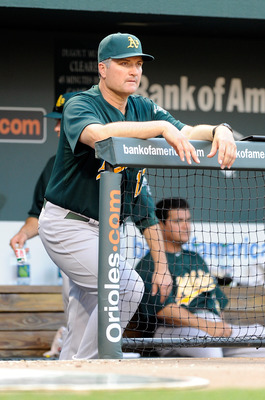 BALTIMORE, MD - JUNE 06:  Manager Bob Geren #17 of the Oakland Athletics watches the game against the Baltimore Orioles at Oriole Park at Camden Yards on June 6, 2011 in Baltimore, Maryland.  (Photo by Greg Fiume/Getty Images)