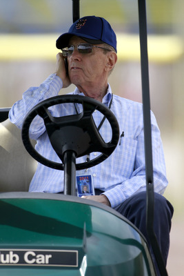 PORT ST. LUCIE, FL - FEBRUARY 17:  Owner Fred Wilpon of the New York Mets talks on the phone during spring training at Tradition Field on February 17, 2011 in Port St. Lucie, Florida.  (Photo by Marc Serota/Getty Images)