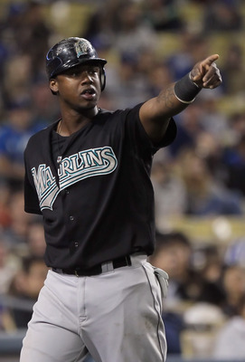 LOS ANGELES, CA - MAY 27:  Hanley Ramirez #2 of the Florida Marlins acknowledges teammate Greg Dobbs (not pictured) after Dobbs drove Ramirez in with a base hit against the Los Angeles Dodgers in the eigth inning at Dodger Stadium on May 27, 2011 in Los A