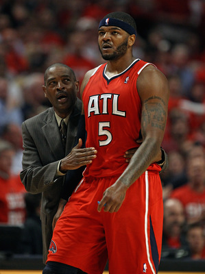 CHICAGO, IL - MAY 10: Head coach Larry Drew of the Atlanta Hawks walks down the court with Josh Smith #5 after an altercation against the Chicago Bulls in Game Five of the Eastern Conference Semifinals in the 2011 NBA Playoffs at the United Center on May