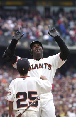 397515 01: (FILE PHOTO) Barry Bonds of the San Francisco Giants (R) celebrates his 73rd home run in front of his son Nikolai October 7, 2001 against the Los Angeles Dodgers at Pacific Bell Park in San Francisco, CA. Bonds won a record 4th Most Valuable Pl